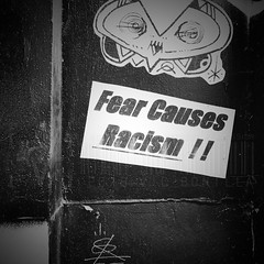 Fear Causes Racism (DrCuervo) Tags: simplybwapp urban seattle iphone monochrome blackandwhite slappers streetphotography racism fear