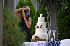 Photo of Photographer (NC Mountain Man) Tags: cake weddingcake photographer tree table glasses camera girl woman pose ncmountainman nikon d3400 phixe flowers dof vine post building candle lowresolutionversion