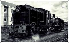NG87 at Porthmadog Harbour-Station (zweiblumen) Tags: ng87 ngg16 1937 garratt 262262 steam locomotive welshhighlandrailways rheilffordderyri porthmadog gwynedd wales cymru monochrome sociétécockerillseraing canoneos50d polariser zweiblumen