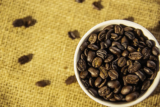 White Cup with Coffee Grains