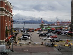 Waterfront Cordova Vancouver Van18i02 LG (CanadaGood) Tags: canada bc britishcolumbia vancouver downtown burrardinlet harbour mountain rain station parking building architecture industry crane canadagood 2018 thisdecade color colour cameraphone