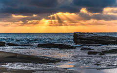 Sun rays bursting through - Sunrise Seascape (Merrillie) Tags: daybreak theskillion dawn nature australia terrigal rocky morning sea waterscape newsouthwales rocks earlymorning nsw coast landscape ocean sunrays cloudy sunrise coastal clouds outdoors seascape waves centralcoast water sky