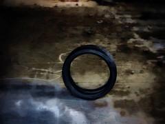 Rimless (Steve Taylor (Photography)) Tags: tyre digitalart black blue brown dark rubber concrete newzealand nz southisland canterbury christchurch newbrighton texture