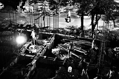 Night Shift. (bell.bb) Tags: construction worker labour labor wall cement rods steel people blackwhite blackandwhite mud together contribute