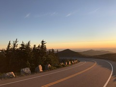A Throwback to Summer: Whiteface Mountain (FluvannaCountyBirder754) Tags: whitefacemountain newyorkstate essexcounty trees conifer evergreen spruce fir road view mountains adirondacks scenery boulder rock sunrise
