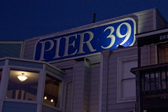 Pier 39 (brucetopher) Tags: sanfrancisco harbor waterfront marina boating pier 39 sealions travel night light lighting sign word wording number thirties thirty thirtynine lamp window lookingin resaurant inn