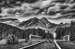 Take me to the mountains (Sean X. Liu) Tags: blackandwhite blackwhite monochrome railway mountains leadinglines longexposure clouds