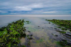 Evening light at Portmarnock beach, Dublin (Helen Mulvey) Tags: d5100 nikon coast beach water tide sea movement landscape seascape longexposure evening sunset ireland dublin portmarnock