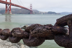 Rust & Red (brucetopher) Tags: rust chain chains rail link links chainlink nautical coast coastline coastal seacoast sea ocean saltwater rusty metal steel red bridge boundary span join connect connection divide division barrier bay sanfrancisco green seawall fort nationalpark park rusted decay old new water