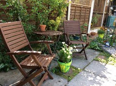 Summer (amanda.parker377) Tags: flowerpots seating gardenfurniture potpainting children'sactivities paintedpots gardens patio