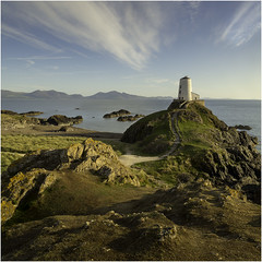 Twr Mawr Lighthouse (Charles Connor) Tags: anglesey twrmawrlighthouse llandwynisland eveninglight lighthouses skies clouds seascape landscapephotography landscape beautyofnature rocks texture shadows sidelight canondslr mountains steps squareformat