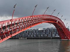 Hoge Brug (RobertLx) Tags: bridge amsterdam water canal sky red building architecture city netherlands europe pythonbridge easterndocklands hogebrug adriaangeuze sporenburg highbridge