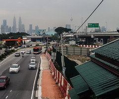 Kuala Lumpur Sentul (Ahmed N Yaghi) Tags: sentul kuala lumpur twin towers petronas kl art house street pavement green rapidkl bus cars city skyline line sky wires fog malaysia
