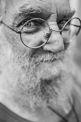 Are you Santa? (Giulio Magnifico) Tags: smile soulful friuliveneziagiulia 28mm streetlife streetphotography traditional cool citylife urbanlife friuli city deepsoul naturallight bw eye old italy trieste blackandwhite candid leicaq detail glasses ancient beard macro leica detailing