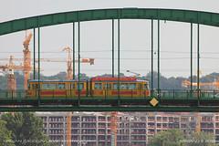 Crossing the Zarić bridge (srkirad) Tags: travel belgrade beograd serbia srbija bridge zarićbridge oldsavabridge savabridge tram green yellow cranes construction architecture trees arc