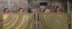 Behind the fence (ybiberman) Tags: israel jerusalem oldcity alquds jewishquarter westernwall wailingwall women people portrait candid streetphotography fence smartphone watch veil tishabav