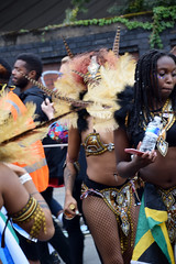 DSC_7900 Notting Hill Caribbean Carnival London Exotic Colourful Gold and Black Costume with Ostrich Feather Headdress Girls Dancing Showgirl Performers Aug 27 2018 Stunning Ladies (photographer695) Tags: notting hill caribbean carnival london exotic colourful costume girls dancing showgirl performers aug 27 2018 stunning ladies gold black with ostrich feather headdress