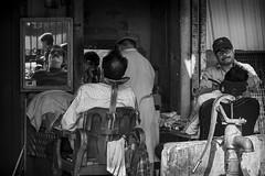 the barbershop by the water pump (charlesgyoung) Tags: charlesyoung olddelhi d500 delhi rajasthan india streetphotography nikon nikonphotography nikondx blackandwhite barber