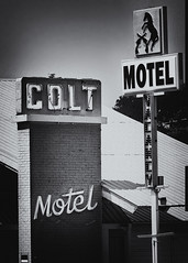 .45 (Orson Wagon) Tags: newmexico neon motel sign overnight room vacant decayed old bed magic fingers small town city mountains pass