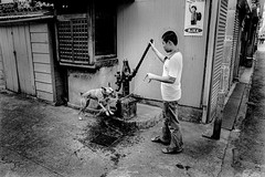 summer day 702 (soyokazeojisan) Tags: japan fukui bw city street summer people dog blackandwhite monochrome analog olympus m1 om1 28mm film trix kodak memories 1970s 1975