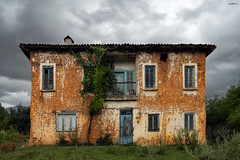 absence (dim.pagiantzas | photography) Tags: absence house traditional old village abandonment abandoned yellow mansion ruins nature field grass plants trees sky clouds cloudy atmospheric colors colorful doors windows wide canon outdoor greece hellas macedonia landscape
