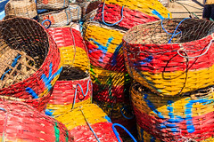Fishermens baskets (HellonEarth2006) Tags: fishermensbaskets jimbaran bali beach blue colorful colourful indonesia net netting red wicker yellow