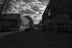 Down The Street (OzGFK) Tags: ilforddelta400 ilford delta400 delta film analog nikon fm2n blackandwhite monochrome collingwood fitzroy redfilter contrast urban streetphotography clouds shadows
