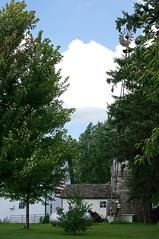 hidden American flag (WORLDS APART PHOTO) Tags: flag americanflag farm buildings barn trees vegetation sky windmill windmillwednesday agriculture wisconsin sewisconsin farmbuildings