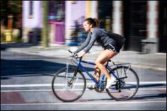 Bank Street Cycling Girl (Dan Dewan) Tags: 2018 canonef70200mmf14lisusm dandewan bicycle bankstreet street people person lady september colour cyclist ottawa sunday woman girl ontario canada panning summer portrait canon