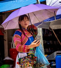 Hmong Woman (Rod Waddington) Tags: vietnam vietnamese streetphotography street hmong minority culture cultural ethnic ethnicity umbrella bag traditional dress costume portrait people outdoor