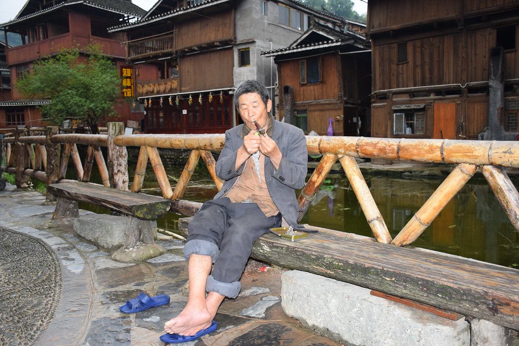 835582fa5 Zhaoxing, Guizhou (jan.hjelmtveit) Tags: china man pipe smoking