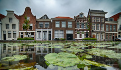 Gouda reflections (PaulHoo) Tags: gouda city urban nikon d750 architecture house 2018 wideangle ultrawideangle samyang 14mm reflection water canal hdr