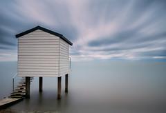 Stranded (Alan Reeve) Tags: osea le long exposure beach huts sky coast sea