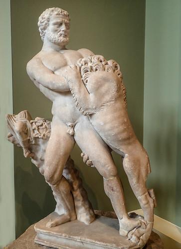 Sculpture of Hercules (with 17th century restored head) battling the Nemean Lion Roman 150-200 CE