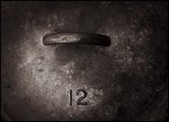 Dutch oven lid (Bob R.L. Evans) Tags: sepiatone metal dutchoven cooking baking composition 12 twelve castiron defamiliarization