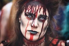 White Eye Zombie (henriksundholm.com) Tags: zombie walk stockholm portrait people female girl woman lady hair face parade blood bloody lipstick mascara makeup horror terror wounded dof bokeh depth field vignette 50mm sverige sweden portraiture zombiewalk