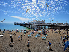 Brighton Palace Pier (brombles) Tags: pebbles pride brightonpride brightonpalacepier pier brightonpier brighton brightonandhove hove sussex seaside huaweip20pro summer summertime coast england english englishism seagulls tourists deckchairs