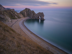 a moment on the beach (Wizard CG) Tags: durdle door hdr dorset olympus epl1 jurassic coast natural limestone arch landscape cliffs shingle beaches world trekker ngc sand fine pebbles sea heritage waves water outdoor