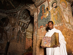 Book of Faces (Magic Pea) Tags: photo photography magicpea ethiopia church priest book christian christianity art