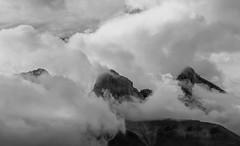 Clouds among the peaks (Robert Grove 2 (on tour)) Tags: mountains rockies peaks clouds bw blackandwhite 3 sisters three trio triple