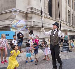 bubbles! (jenny_guo) Tags: london street performance performer bubble children people girls kid fun xpro2 x 18mm f2 fujinon uk