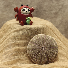 Sea Urchin and Furry Bones Lobster (N.the.Kudzu) Tags: tabletop stilllife seaurchin furrybones figurine canondslr zenitar50mmf12 lightroom