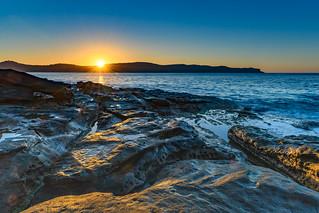 Early Morning Seascape with Sunburst
