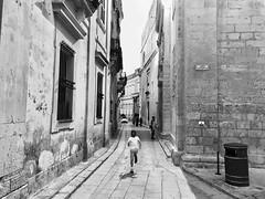 Running away from a silent city. (AchillWandering) Tags: mono architecture escape running kid children child silentcity blackandwhite bw monochrome mdina malta downtown