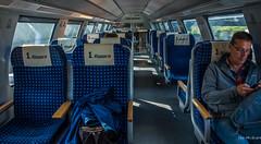2018 - Germany - Düsseldorf - Deutsche Bahn (Ted's photos - For Me & You) Tags: 2018 cropped dã¼sseldorf germany nikon nikond750 nikonfx tedmcgrath tedsphotos vignetting train düsseldorf traincar seating seats seated 1klasse db blue railway backpack glasses cellphone shadow shadows deutschebahn