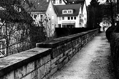 A black shape (Leica M6) (stefankamert) Tags: stefankamert street black shape analog analogue film grain leica leicam6 m6 dualrange dr summicron kodak trix blackandwhite blackwhite noir noiretblanc wall balingen