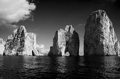 Capri Arches (mitchriley) Tags: capri italy black white contrast arches water rocks clouds bw