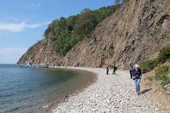 Lake Baikal Beach Hike (peterkelly) Tags: digital asia siberia canon 6d gadventures transmongolianadventure russianfederation russia lakebaikal water boat lake slope hillslope beach shore shoreline walking woman trees