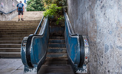 2018 - Germany - Munich - Stair Climb (Ted's photos - Returns Late November) Tags: 2018 cropped germany munich münchen nikon nikond750 nikonfx tedmcgrath tedsphotos vignetting backpack stairs steps escalator munichgermany railing male man walking walker
