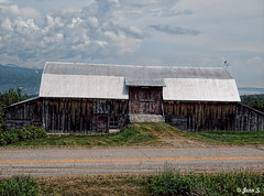 ... (Jean S..) Tags: barn rural grass road sky clouds old green outdoors yellow blue